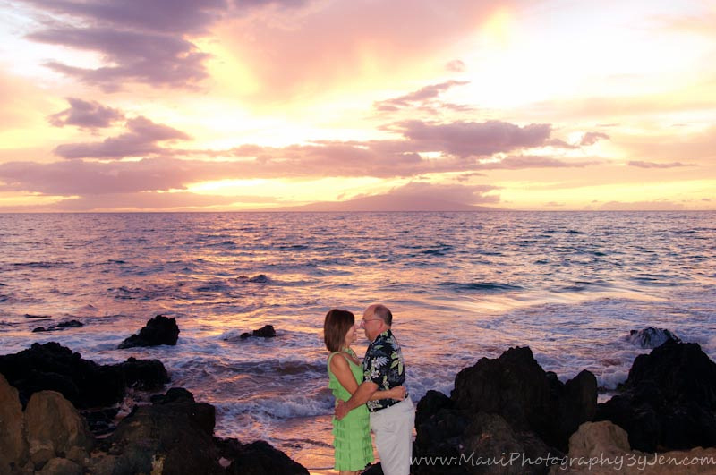 photographer in maui with rocks and sunset