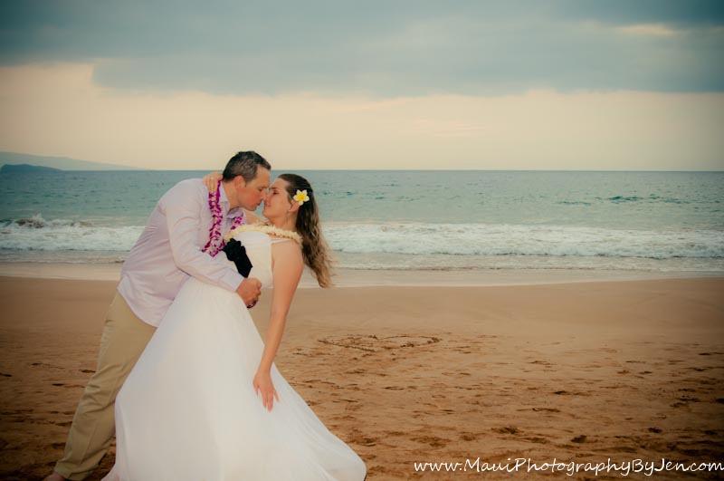 maui photographer with honeymoon couple on the beach