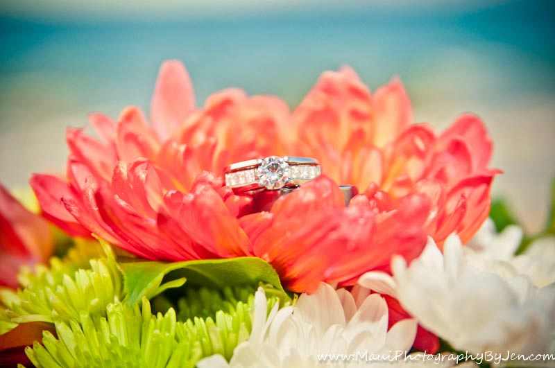 maui wedding photographer with rings and flowers