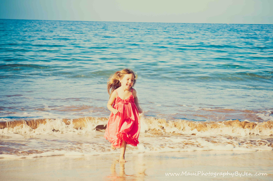 child photographer in maui with girl on the beach