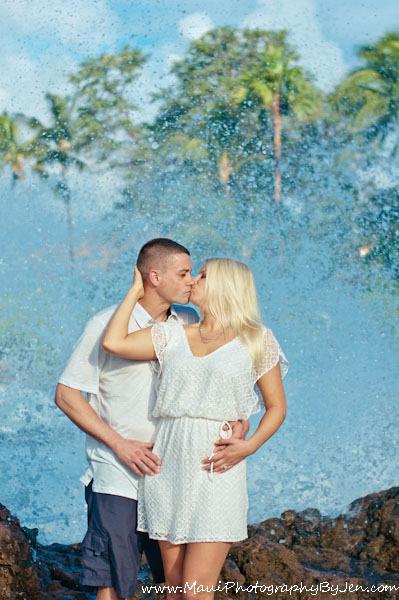 maui photographers with couple water splashing