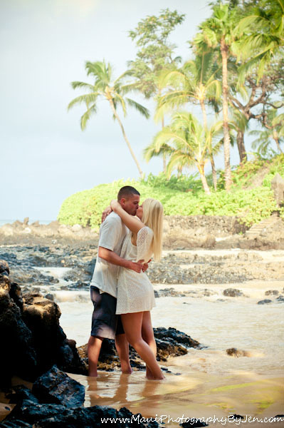 photographers in maui at beach with couple kissing