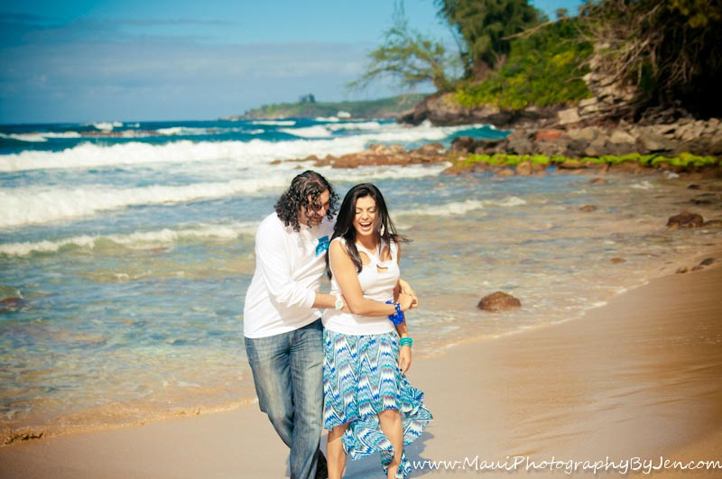 photography in maui with couple playing on the beach