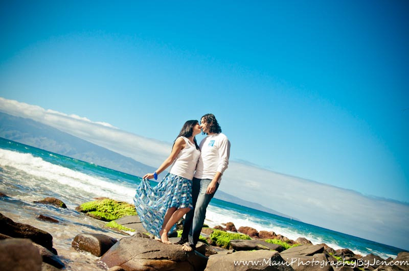 photography in maui with couple on top of rocks in ocean