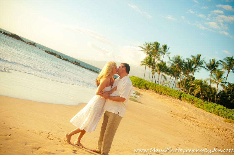 photography in maui with couple kissing on beach