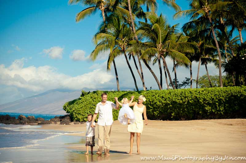 maui photographers with family playing on the beach