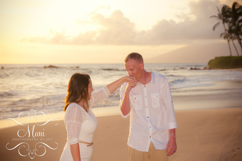 photographers in maui with couple kissing hand