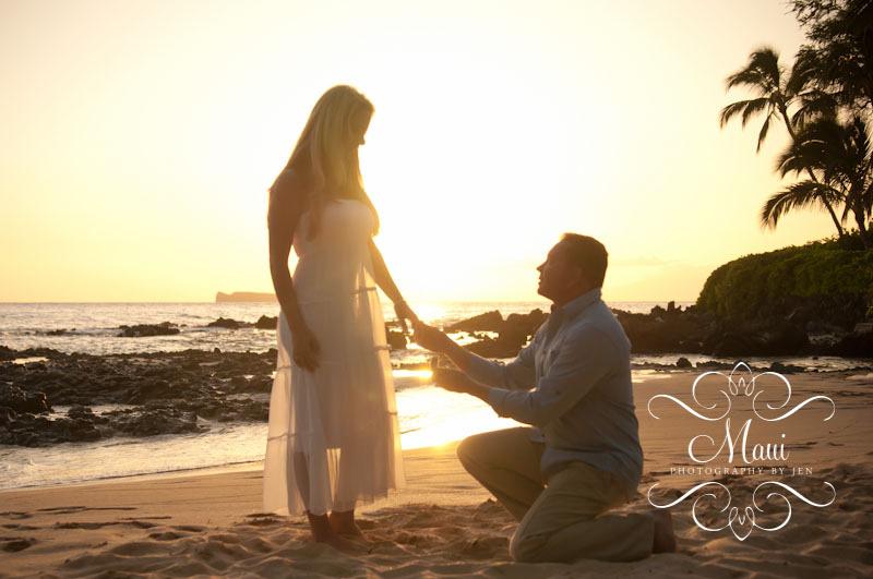 maui photographers with couple engaged at sunset