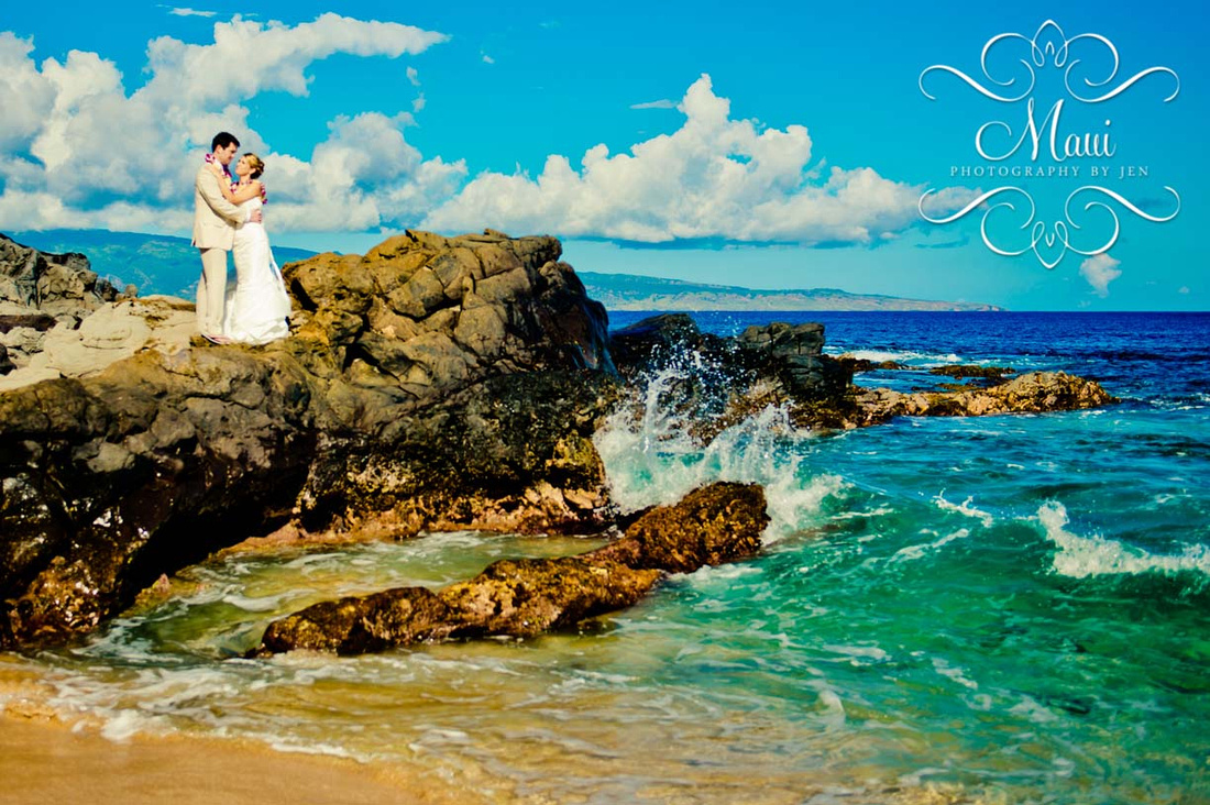 Wedding Photographers in Maui of couple on rocks with the ocean crashing in Lahaina.