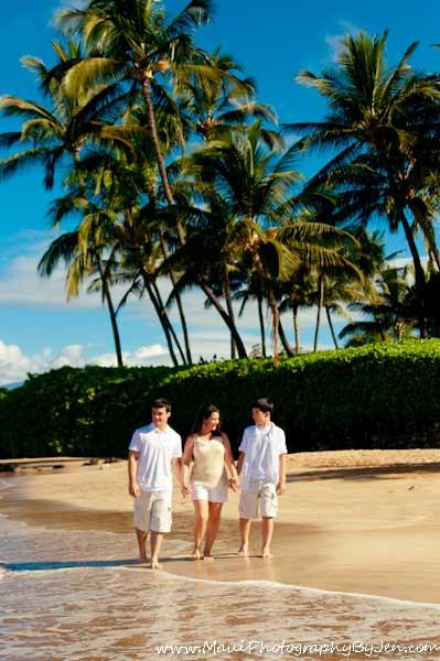 maui family photographer on the beach with palm trees