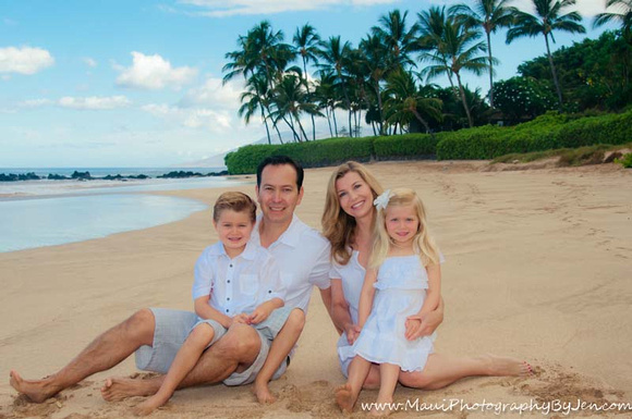 photographer in maui on the beach with family