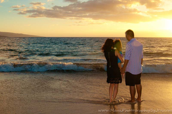 photographer in maui at sunset with family