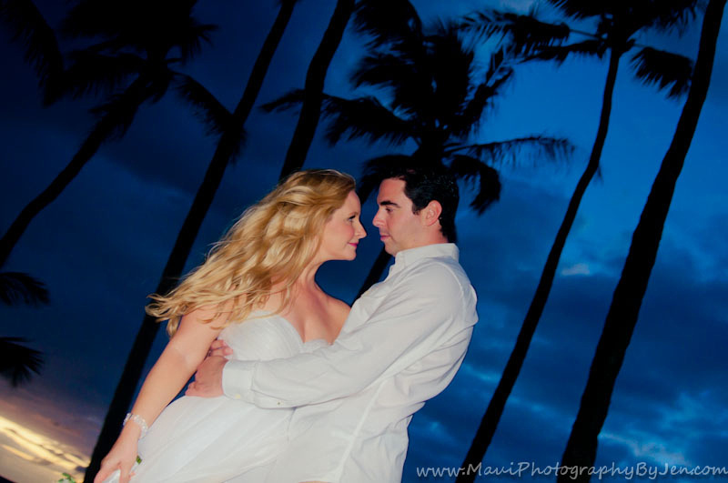 silhouette of bride and groom by photographer in maui