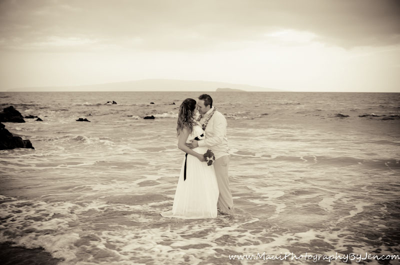 maui wedding photographer with couple in the ocean