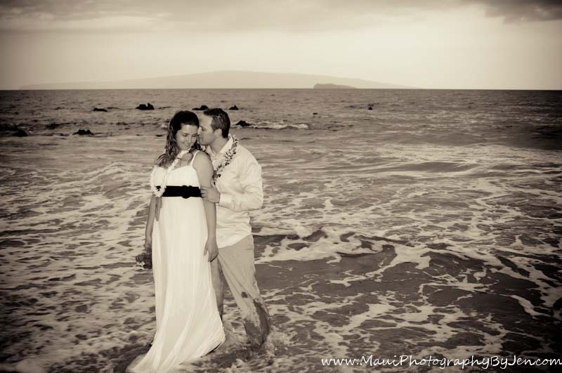 maui photographers with honeymoon couple in the ocean at sunset