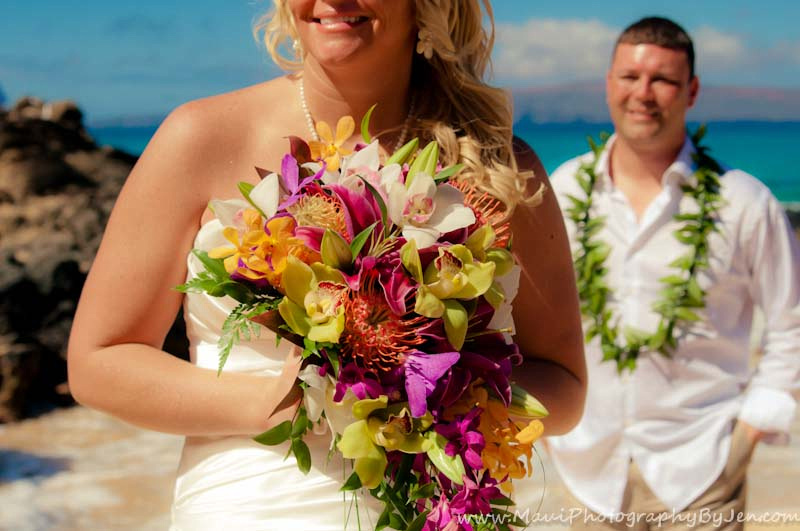 maui wedding photography with flowers and bride