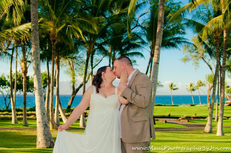 maui wedding photographer kissing and palm trees