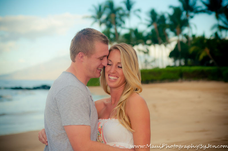 maui photographer with couple laughing on the beach