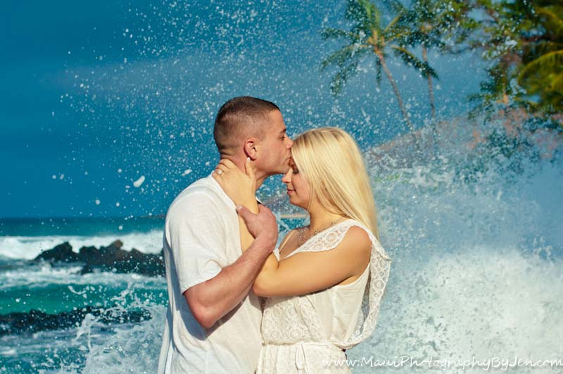 maui photographer with honeymoon couple and ocean splash