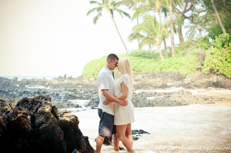 photography in maui with couple by rocks and palm trees