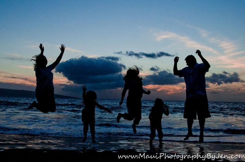 maui photography family jumping at sunset