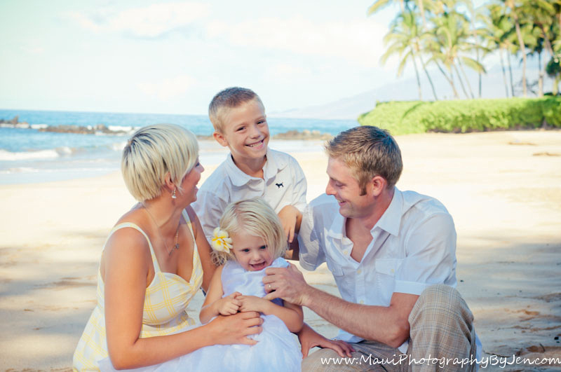 photographer in maui with family laughing and playing