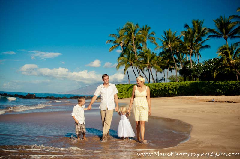 photographer in maui with family walking on the beach