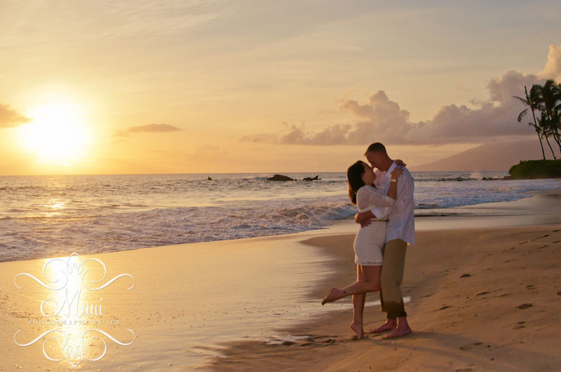 photographers in maui at sunset with couple in love