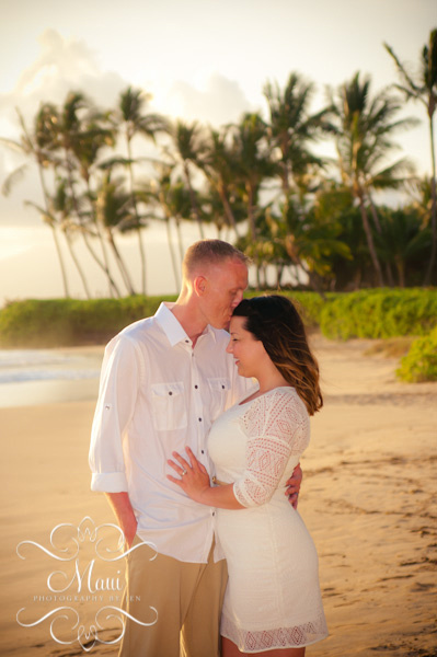 photographers in maui with couple kissing