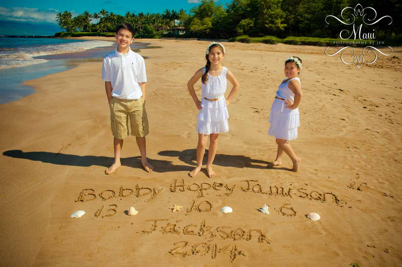 Family photographers in maui with kids on the beach