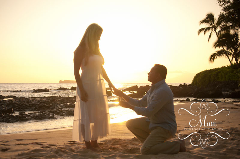 maui photographers with couple engaged at sunset