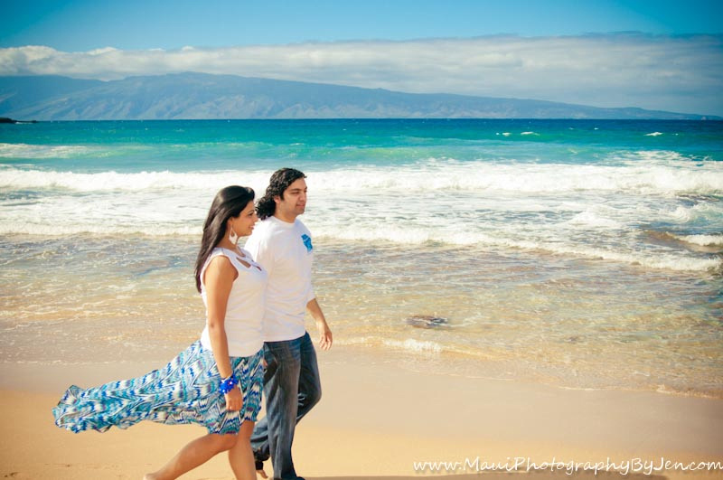 photographer in maui with couple walking on the beach