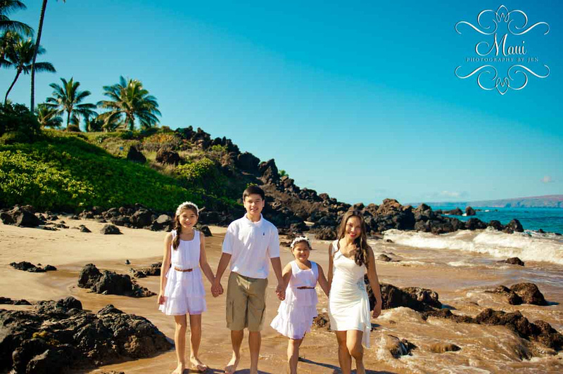 Maui photographer with family on the beach in wailea