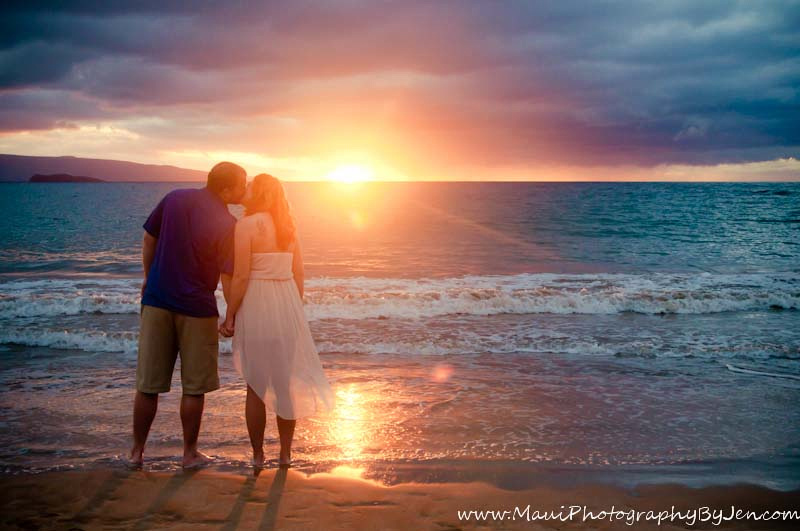photographer in maui with engaged couple at sunset